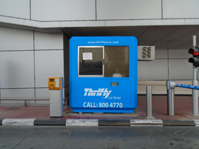 thrifty car rental branding dominating the airport eco